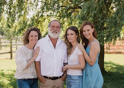 Dad and his girls under the willow tree